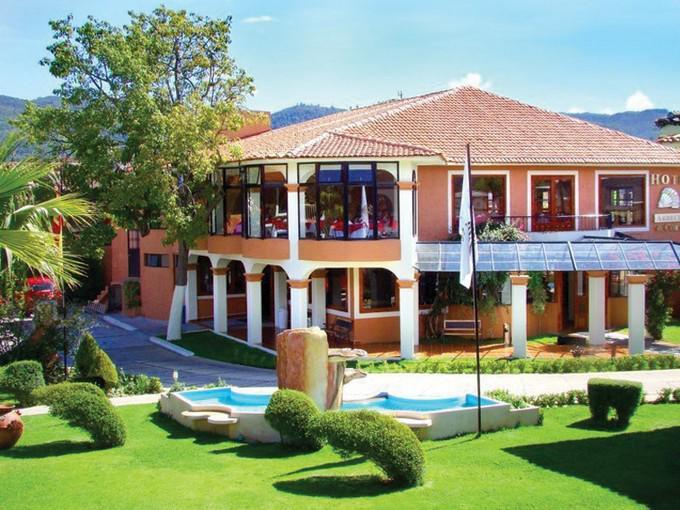 Hotel arrecife de coral ofertas de hoteles en san for Jardines bonitos para casas pequenas