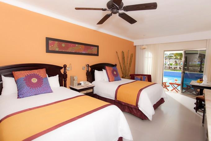 Paquete el dorado royale paquetes familiares en riviera maya for Paquete familiar en un hotel