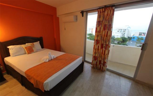 Calypso Hotel, luminosas habitaciones