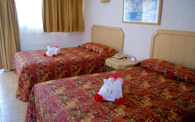 Hotel Qualton Club Ixtapa, amplias y luminosas habitaciones