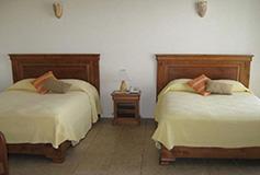 Habitación Estándar Cuádruple Dos Camas Matrimoniales del Hotel Casa del Rio