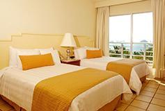 Habitación Superior Vista a la Montaña AI Dos Camas Dobles del Hotel Emporio Ixtapa