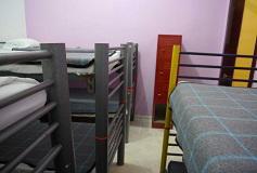 Habitación Dormitorio 8 Camas Mixto del Hotel Hostal Amigo
