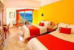 Habitación Superior Dos Camas Parcial al Mar del Hotel Hotel Copacabana Acapulco Beach