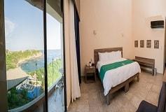 Habitación De Lujo King con Vista Parcial al Mar del Hotel Hotel Coral Blue Huatulco