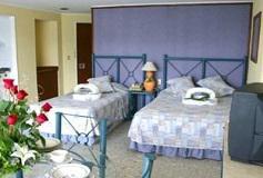 Habitación Suite Con Cocineta Vista Parcial al Mar del Hotel Hotel Las Torres Gemelas