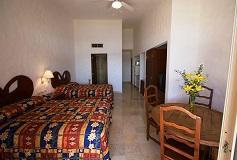 Habitación Estudio con 2 Camas Matrimoniales y Cocineta del Hotel Hotel Quijote Inn