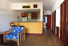 Habitación Junior Suite Una Cama King y Cocineta del Hotel Hotel Quijote Inn