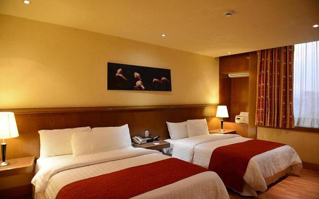 Habitación Estándar Dos Camas Queen No Fumar del Hotel Hotel Ramada Vía Veneto Ciudad de México Sur