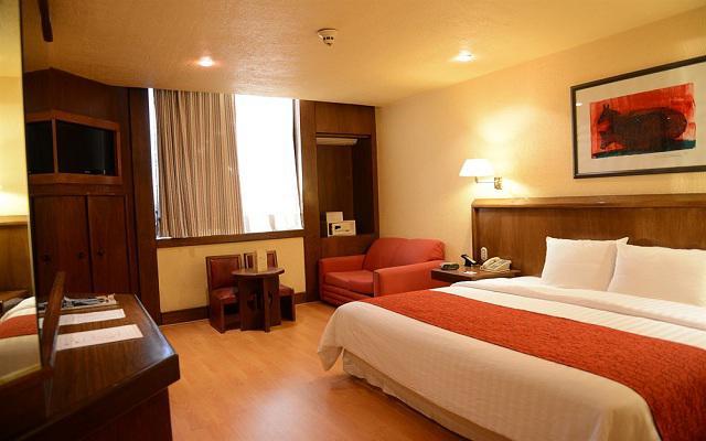 Habitación Junior Suite Una Cama King No Fumar del Hotel Hotel Ramada Vía Veneto Ciudad de México Sur