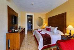 Habitación Junior Suite Vista a la Piscina del Hotel Secrets Aura Cozumel