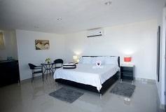 Habitación Master Suite con Terraza del Hotel Sunrise 42 Suites Hotel