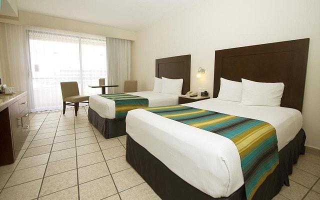Hotel Crown Paradise Club Cancún, amplias y luminosas habitaciones