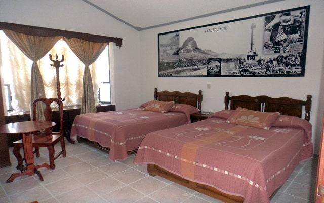 Hotel Don Porfirio, habitaciones decoradas con fotos de época