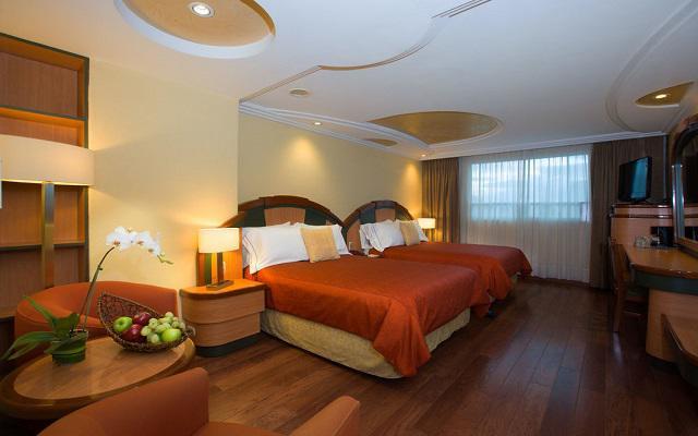 Habitación con dos camas ideales para viajes en familia