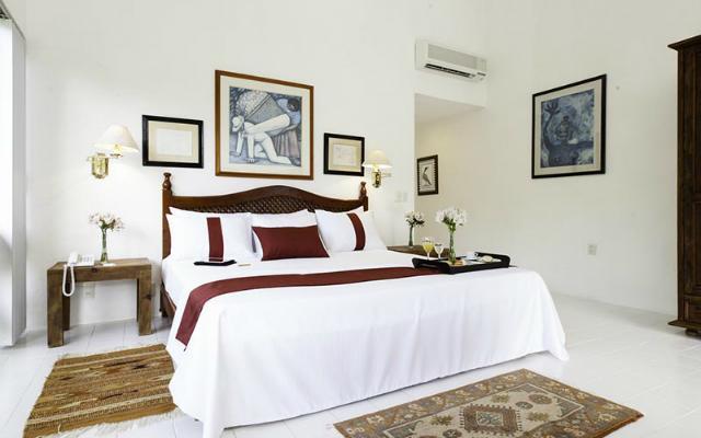 Hotel Misión Palenque, habitaciones rodeadas de frondosos árboles