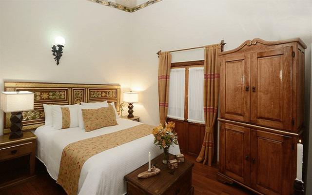 Hotel Misión Pátzcuaro Centro Histórico, habitaciones decoradas con un estilo colonial