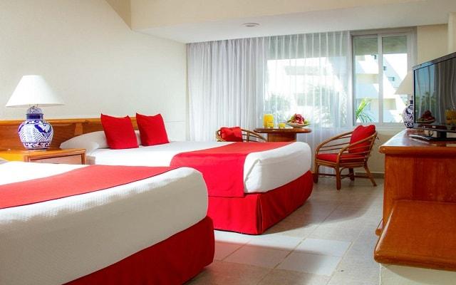 Hotel Oasis Palm, habitaciones con todas las amenidades