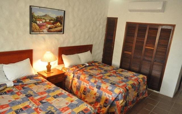 Hotel Quijote Inn, amplias y luminosas habitaciones
