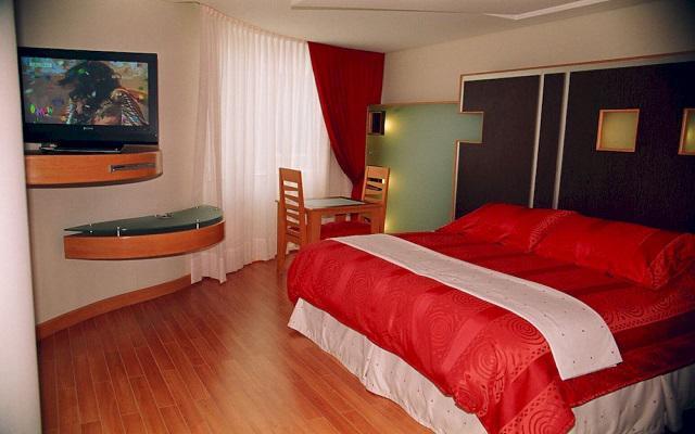 Habitación con una cama.