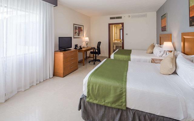 Hotel Wyndham Garden Playa del Carmen, ofrece habitaciones con una o dos camas