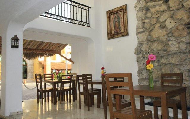 María Candelaria Hotel, dispone de una zona de estar común abierto las 24 hrs
