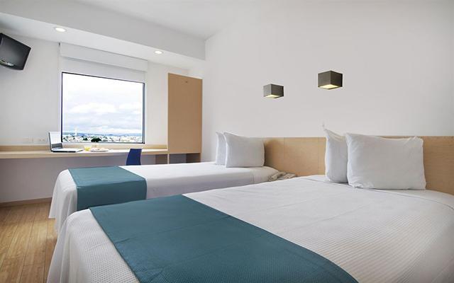 Hotel One Toluca Aeropuerto, habitaciones cómodas y acogedoras